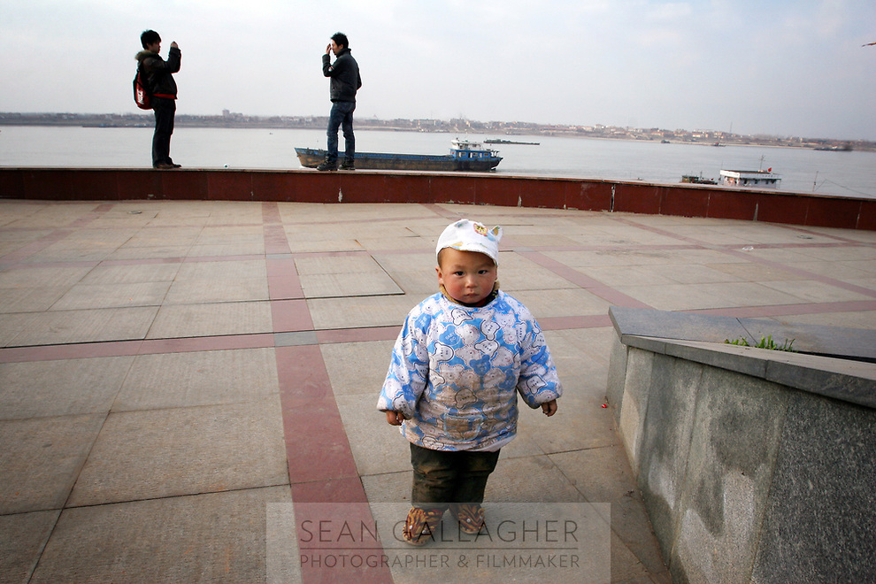 CHINA. Jiangxi Province.  Jiujiang. A young child near the banks of the Yangtze. Jiujiang is a city of 4.6 million people, located on the southern shore of the Yangtze River. The Yangtze River is reported to be at its lowest level in 150 years as a result of a country-wide drought. It is China's longest river and the third longest in the world. Originating in Tibet, the river flows for 3,964 miles (6,380km) through central China into the East China Sea at Shanghai.  2008