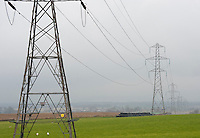 Electricity pylons going through farm land and fields, Forfar, Angus, Scotland.