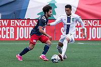 FOXBOROUGH, MA - JULY 4: Ryan Spaulding #34 of the New England Revolution II and William Mejia #2 of Greenville Triumph SC battle for the ball during a game between Greenville Triumph SC and New England Revolution II at Gillette Stadium on July 4, 2021 in Foxborough, Massachusetts.