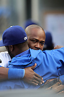 Juan Uribe #5 of the Los Angeles Dodgers hugs teammate Tony Gwynn jr. #10 before game against the Milwaukee Brewers at Dodger Stadium in Los Angeles,California on May 16, 2011. Photo by Larry Goren/Four Seam Images