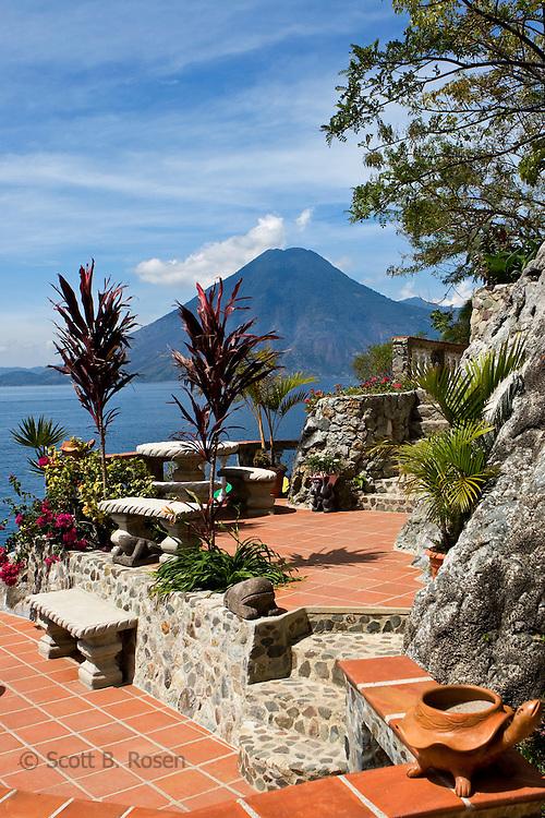 Patio overlooking volcanoes at a hotel on Lake Atitlan, Guatemala