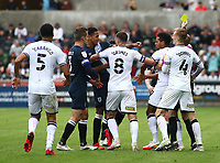 25th September 2021; Swansea.com Stadium, Swansea, Wales; EFL Championship football, Swansea versus Huddersfield; Levi Colwill of Huddersfield Town and Korey Smith of Swansea City are separated after a late challenge in the second half