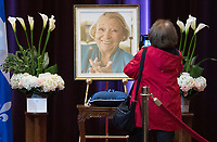 A woman pays her respects to Lise Payette during a memorial service in her honour at City Hall in Montreal, Saturday, October 20, 2018. THE CANADIAN PRESS/Graham Hughes