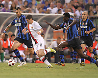 Marco Materazzi #23 and McDonald Mariga #17 of Inter Milan close in on Adam Johnson #11 of Manchester City during an international friendly match on July 31 2010 at M&T Bank Stadium in Baltimore, Maryland. Milan won 3-0.
