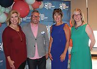 Blake Woolsey (from left), Randy Werner, Jody Dilday and Emily Ironside visit at the SPSFNWA merger celebration.<br /> (NWA Democrat-Gazette/Carin Schoppmeyer)