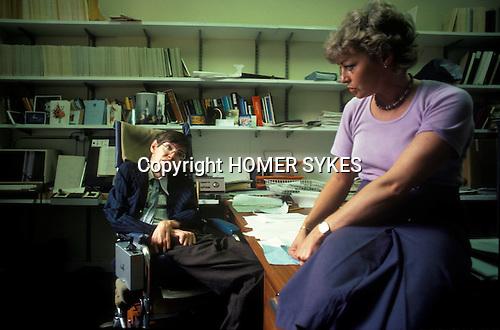 Professor Stephen Hawking Cambridge University in his office with his secretary Judy Fella. Cambridge UK 1981.