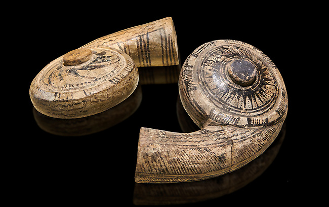 Two decorated terra cotta seashell shaped vessels found in the house of Assyrian trader, Elamma, at the second level of the Karum of Kultepe. - 19th to 17th century BC - Kültepe Kanesh - Museum of Anatolian Civilisations, Ankara, Turkey.  Against a black background.