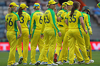 The Australian team celebrates a wicket as Ashleigh Gardner (centre) checks the scoreboard during the 2nd international women's T20 cricket match between the New Zealand White Ferns and Australia at McLean Park in Napier, New Zealand on Tuesday, 30 March 2021. Photo: Dave Lintott / lintottphoto.co.nz