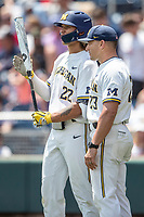 Michigan Wolverines outfielder Jordan Brewer (22) talks with head coach Erik Bakich (23) during Game 11 of the NCAA College World Series against the Texas Tech Red Raiders on June 21, 2019 at TD Ameritrade Park in Omaha, Nebraska. Michigan defeated Texas Tech 15-3 and is headed to the CWS Finals. (Andrew Woolley/Four Seam Images)