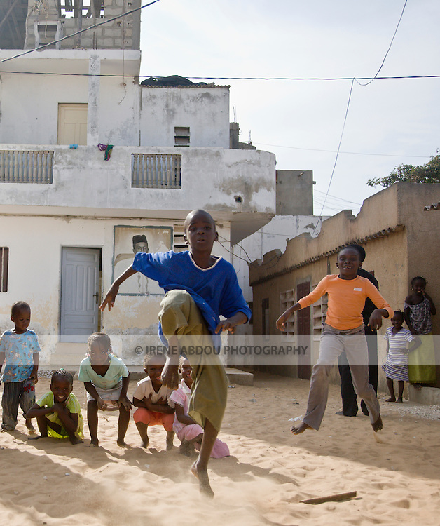 Children jump, laugh, smile, and play in the fishing village of Yoff, 30 minutes from Senegal's capital city of Dakar.
