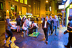 """© Joel Goodman - 07973 332324 . 17/12/2016 . Manchester , UK . A woman stumbles over an A board on Withy Grove . Revellers out in Manchester City Centre overnight during """" Mad Friday """" , named for being one of the busiest nights of the year for the emergency services in the UK . Photo credit : Joel Goodman"""