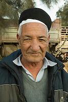 Tripoli, Libya - Libyan Man Wearing Tunisian Cap (Chechia).  This man is selling sheep to be sacrificed for the Eid al-Adha.