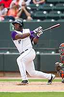Courtney Hawkins (10) of the Winston-Salem Dash follows through on his swing against the Frederick Keys at BB&T Ballpark on May 18, 2014 in Winston-Salem, North Carolina.  The Dash defeated the Keys 7-6.  (Brian Westerholt/Four Seam Images)