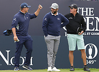 14th July 2021; The Royal St. George's Golf Club, Sandwich, Kent, England; The 149th Open Golf Championship, practice day; Phil Mickelson (USA) greets his playing partners Bryson Dechambeau (USA) and Jon Rahm (ESP) on the 1st tee