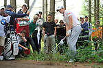 Gary Boyd (ENG) chips out of the woods after taking a drop on the 16th hole during of Day 3 of the BMW International Open at Golf Club Munchen Eichenried, Germany, 25th June 2011 (Photo Eoin Clarke/www.golffile.ie)