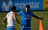 BARRANQUILLA - COLOMBIA - 20 – 03 - 2017: James Rodriguez (Izq.), jugador de la Selección Colombia, recibe instucciones de Patricio Camps (Der.), integrante del cuerpo técnico, durante entreno en las canchas del Polideportivo Universidad Autonoma del Caribe. El equipo colombiano se prepara en Barranquilla para el partido contra el seleccionado de Bolivia el 23 de marzo, partido clasificatorio a la Copa Mundial de la FIFA Rusia 2018. / James Rodriguez (L), Colombia national team player, receives instructions from Patricio Camps (R), member of the coaching staff, during a training in the grounds of the Sports Center of Autonoma del Caribe University. Colombia team prepares in Barranquilla for the match against the national team of Bolivia on March 23, qualifying for the FIFA World Cup Russia 2018. Photo: VizzorImage / Luis Ramirez/ Staff.