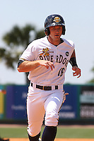 Rob Lyerly #16  of the Charleston RiverDogs running to 3rd base during a game against the Rome Braves on April 27, 2010 in Charleston, SC.