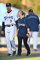 Asheville Tourists pitching coach Ryan Kibler (9) and trainer Kelsey Branstetter during a game against the Rome Braves at McCormick Field on April 17, 2018 in Asheville, North Carolina. The Tourists defeated the Braves 1-0. (Tony Farlow/Four Seam Images)