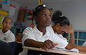 Sixth-grader Aaliyah Brown listens to principal Doris Hicks at the Dr. Martin Luther King Charter School for Science and Technology in New Orleans, Tuesday, Oct. 16, 2007.<br />(Cheryl Gerber photo)