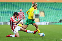 13th February 2021; Carrow Road, Norwich, Norfolk, England, English Football League Championship Football, Norwich versus Stoke City; Todd Cantwell of Norwich City takes on Morgan Fox of Stoke City