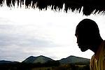Gabonese researcher, Ulrich Bogendre, looking out into landscape, Lope National Park, Gabon