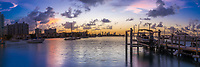Colorful sunset on Miami's Biscayne Bay, Venetian Islands, and boats, from Miami Beach marina near the Art Deco district, Florida USA