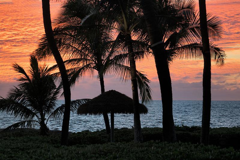 Beach and umbrella at sunset. Ko Olina, Oahu, Hawaii.