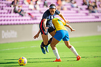 ORLANDO CITY, FL - FEBRUARY 21: Lynn Williams #6 and Tamires battle for the ball during a game between Brazil and USWNT at Exploria Stadium on February 21, 2021 in Orlando City, Florida.