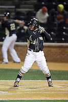 Nate Mondou (10) of the Wake Forest Demon Deacons at bat against the Delaware Blue Hens at Wake Forest Baseball Park on February 13, 2015 in Winston-Salem, North Carolina.  The Demon Deacons defeated the Blue Hens 3-2.  (Brian Westerholt/Four Seam Images)