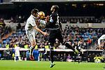 Real Madrid James Rodriguez and Deportivo de la Coruña Sidnei Rechel during La Liga match between Real Madrid and Deportivo de la Coruña at Santiago Bernabeu Stadium in Madrid, Spain. December 10, 2016. (ALTERPHOTOS/BorjaB.Hojas)