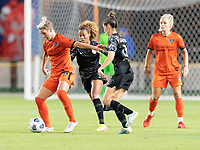 Sophie Schmidt #13 of the Houston Dash attempts to dribble the ball away from Casey Krueger #6 and Morgan Gautrat #13 of the Chicago Red Stars during a game between Chicago Red Stars and Houston Dash at BBVA Stadium on September 10, 2021 in Houston, Texas.