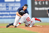 Beer City Tourists shortstop Ryan Vilade (4) fields the ball and tags out a hard sliding Ricardo Cubillan (10) during a game against the Greenville Drive at McCormick Field on May 24, 2018 in Asheville, North Carolina. The Tourists defeated the Drive 4-2. (Tony Farlow/Four Seam Images)