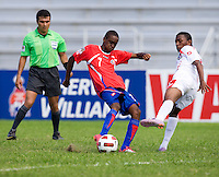 Dario Wright (7) of Panama tries to defend the shot of Jake Beckford (7) of Costa Rica during the quarterfinals of the CONCACAF Men's Under 17 Championship at Catherine Hall Stadium in Montego Bay, Jamaica. Panama defeated Costa Rica, 1-0.