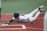 Will Butcher (18) of the Charlotte 49ers slides across home plate during the game against the Old Dominion Monarchs at Hayes Stadium on April 23, 2021 in Charlotte, North Carolina. (Brian Westerholt/Four Seam Images)