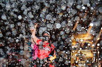 Nov 1, 2020; Las Vegas, Nevada, USA; NHRA pro stock driver Erica Enders celebrates with champagne after winning the 2020 pro stock World Championship at the NHRA Finals at The Strip at Las Vegas Motor Speedway. Mandatory Credit: Mark J. Rebilas-USA TODAY Sports