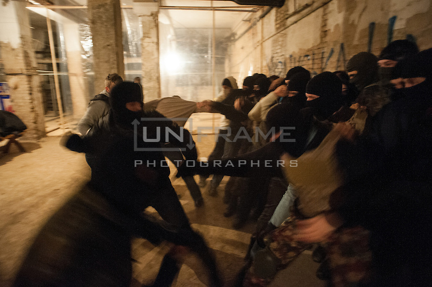 Right wing nationalists train on various group assault techniques in the basement of the city hall taken by Euromaidan protesters in Kiev