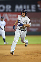 Jose Torrealba (9) of the Princeton Rays rounds the bases after hitting a home run against the Pulaski Yankees at Calfee Park on July 14, 2018 in Pulaski, Virginia. The Rays defeated the Yankees 13-1.  (Brian Westerholt/Four Seam Images)