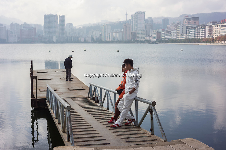 """Residents relax at the lake side in Gejiu, December 2014. Gejiu in Yunnan province is a """"Tin Centre"""" with more than 2,000 years of mining history. Tin articles made in Gejiu are highly acclaimed in China. However, the tin mining and related industries are in decline."""