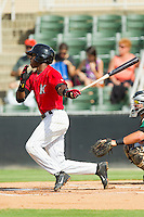 Tim Anderson (2) Kannapolis Intimidators follows through on his swing against the Greensboro Grasshoppers at CMC-Northeast Stadium on July 13, 2013 in Kannapolis, North Carolina.  The Intimidators defeated the Grasshoppers 7-5.   (Brian Westerholt/Four Seam Images)