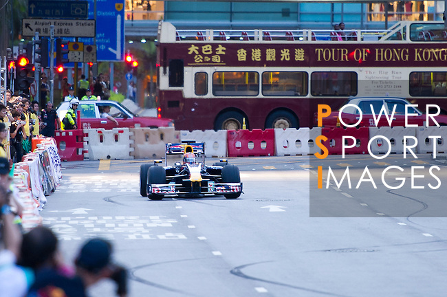 Red Bull Toro Rosso driver Jaime Alguersuari drives his Formula 1 car on Hong Kong's Lung Wo Road during the Red Bull Dragon Run 2011 in Hong Kong, China on the 18th June 2011.