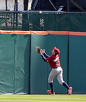 Lehigh Valley IronPigs outfielder Rich Thompson #12 catches a fly ball over his shoulder during a game against the Buffalo Bisons at Coca-Cola Field on April 19, 2012 in Buffalo, New York.  Lehigh Valley defeated Buffalo 8-4.  (Mike Janes/Four Seam Images)