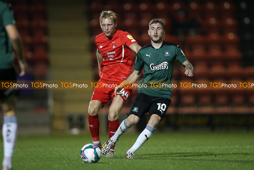 Josh Wright of Orient and Danny Mayor of Plymouth Argyle during Leyton Orient vs Plymouth Argyle, Caraboa Cup Football at The Breyer Group Stadium on 15th September 2020