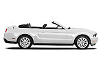 Passenger side profile view of a 2011 ford mustang gt premium convertible.