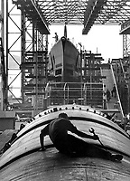 Man working on hull of U.S. submarine at Electric Boat Co., Groton, Conn.  August 1943.  Lt. Comdr. Charles Fenno Jacobs. (Navy)<br /> Exact Date Shot Unknown<br /> NARA FILE #:  080-G-468517<br /> WAR & CONFLICT BOOK #:  820