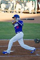 Ogden Raptors third baseman Alex Santana #21 at bat against the Grand Junction Rockies at Lindquist Field on June 27, 2013 in Ogden, Utah. (Stephen Smith/Four Seam Images)