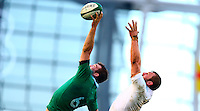 01.03.2015.  Dublin, Ireland. 6 Nations International Rubgy Championship. Ireland versus England.<br /> Peter O'Mahony (Ireland) stretches for the ball ahead of Chris Robshaw (Captain England).
