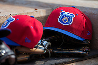 A Tennessee Smokies cap sits on top of a glove in the visitor's dugout during the game against the Birmingham Barons at Regions Field on May 3, 2015 in Birmingham, Alabama.  The Smokies defeated the Barons 3-0.  (Brian Westerholt/Four Seam Images)