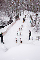Saturday, March 3, 2012  Ken Anderson runs on the bike trail into a culvert underpassing the Seward Higheay during the Ceremonial Start of Iditarod 2012 in Anchorage, Alaska.