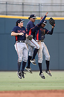 Outfielders Bradley Keller (14), Cristian Pache (25) and Isranel Wilson (20) of the Rome Braves celebrate the win in game one of a doubleheader against the Columbia Fireflies on Saturday, August 19, 2017, at Spirit Communications Park in Columbia, South Carolina. Rome won, 8-2. (Tom Priddy/Four Seam Images)