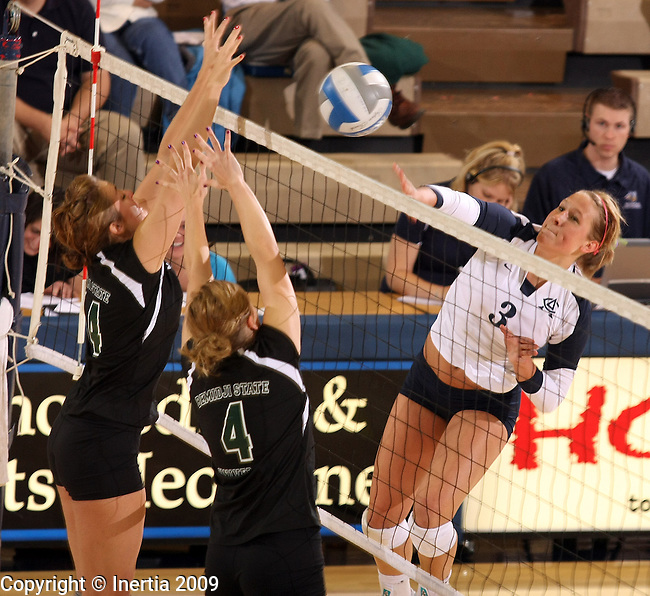 SIOUX FALLS, SD - NOVEMBER 6: Brooke Lewko #3 of Augustana tries to get a kill past Melissa McNeely #14 and Laura Slinger #4 of Bemidji State in the second game of their match Friday night at the Elmen Center. (Photo by Dave Eggen/Inertia)